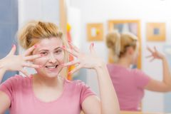 Young woman having gel mask on face. Facial dry skin and body care, complexion treatment at home concept. Young woman having gel peel off mask on her face Stock Photography