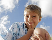 Facial Expression. Kid with a funny facial expression stock photo