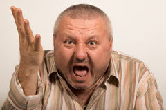 Facial expression of an angry man yelling Stock Photography