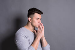 Facial expression and emotion, Hopeful man praying Royalty Free Stock Images