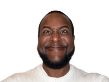 Facial expression - funny sadistic grin. Sadistic grin funny face shot of a African American male showcasing facial expression stock photo