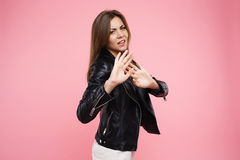 Facial expression. Irritated woman with hands up as sign stop Stock Photos