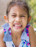 Facial expression of a little girl Stock Photos
