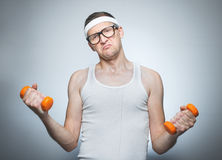 Facial expression nerd with dumbbells royalty free stock images
