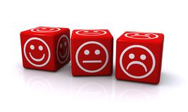 Facial expressions on dice. Three small red cubes each with a cartoon-like face but with different  expressions drawn in white, including  happy, sad, and Royalty Free Stock Photography