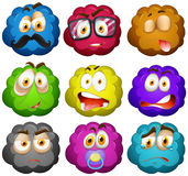 Facial expressions on fluffy balls Royalty Free Stock Photo