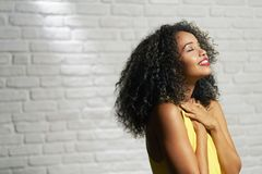 Facial Expressions Of Young Black Woman On Brick Wall Stock Images