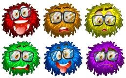 Facial expressions on pompom Stock Photos