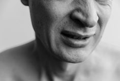 Facial expressions  rejection. The lower part of the face of a man closeup. Black and white images Royalty Free Stock Photo