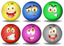 Facial expressions on round balls Royalty Free Stock Image