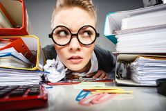 Crazy thoughtful accountant businesswoman. Royalty Free Stock Image