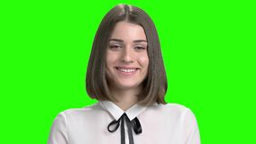 Facial expressions of young brunette girl fall in love. Adorable brown-eyed woman portrait. Green screen hromakey background for keying stock video