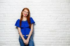 Facial Expressions Of Young Redhead Woman On Brick Wall Stock Photos