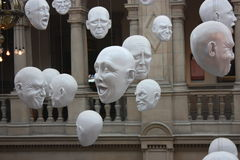 Facial expresstions - at The Kelvingrove Art Gallery and Museum in Glasgow. A view of hanging faces with expressions - at The Kelvingrove Art Gallery and Museum Stock Image