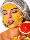 Facial fruits mask for woman. Girl with mango pulp face. Royalty Free Stock Images