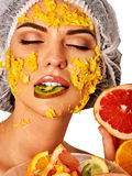 Facial fruits mask for woman. Girl with mango pulp face. Stock Photography
