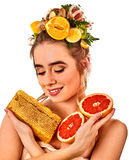 Facial honey mask for woman lips. Honeycombs natural homemade threatment. Royalty Free Stock Image