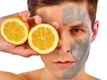 Facial man mask from fruits and clay. Face mud applied. royalty free stock images