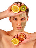 Facial man mask from fruits and clay. Face mud applied. Stock Photography