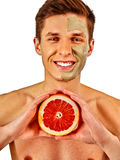 Facial man mask from fruits and clay . Face mud applied. Stock Images