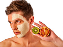 Facial man mask from fruits and clay . Face mud applied. Royalty Free Stock Photo