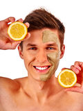 Facial man mask from fruits and clay . Face mud applied. Stock Photo
