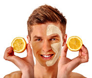 Facial man mask from fruits and clay . Face mud applied. Stock Photos