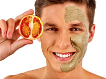 Facial man mask from fruits and clay . Face mud applied. Royalty Free Stock Photography