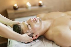 Facial masage. View at the facial massage being done Royalty Free Stock Photo