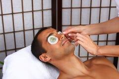 Facial Mask. Young man receiving mask - SPA Stock Photos