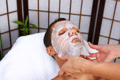 Facial Mask. Young man receiving mask - SPA Stock Images