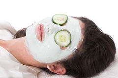 Facial mask. Pretty woman lying and relaxing with a facial mask Stock Photo