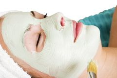 Facial Mask. A detail image of a green apple mask being applied at a beauty spa Royalty Free Stock Image