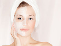 Facial mask on beautiful face stock images