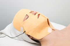 Facial mask electrophoresis procedure Stock Photos