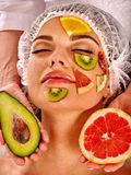 Facial mask from fresh fruits for woman. Girl beautiful face. Stock Images