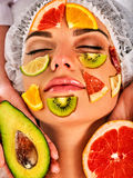 Facial mask from fresh fruits for woman. Girl beautiful face. Stock Photo