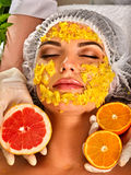 Facial mask from fresh fruits for woman. Girl beautiful face. Royalty Free Stock Images