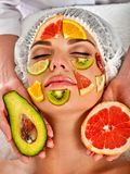 Facial mask from fresh fruits for woman. Girl beautiful face. Stock Photography