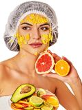 Facial mask from fruits for woman. Girl in medical hat. Royalty Free Stock Photo