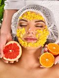 Facial mask from fruits for woman. Girl in medical hat. Stock Photos