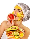 Facial mask from fruits for woman. Girl in medical hat. Stock Photography