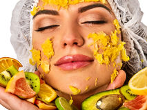 Facial mask from fruits for woman . Girl in medical hat. Royalty Free Stock Image