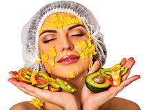 Facial mask from fruits for woman . Girl in medical hat. Stock Photography