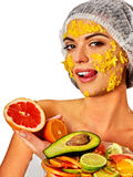 Facial mask from fruits for woman. Girl in medical hat. Stock Photo