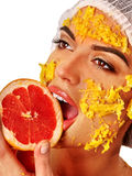 Facial mask from fruits for woman . Girl in medical hat. Stock Photo