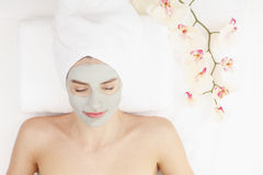 Facial mask. Healthy spa: young beautiful relaxing woman having moistening mask Stock Photo
