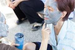 Facial mask with mud Stock Images