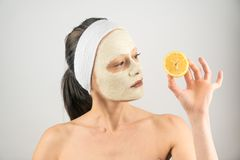 FACIAL MASK. PROBLEM SKIN MASK CLAY AND LEMON WOMAN SKIN CARE royalty free stock photography