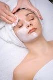Facial mask removing at beauty salon. Beauty salon series. facial mask removing Stock Image